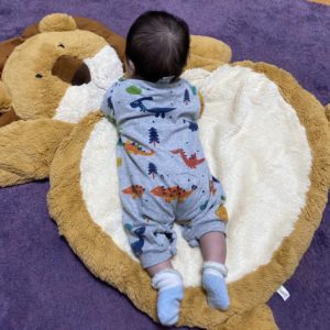 newborn on mat