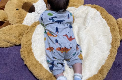 newborn on mat